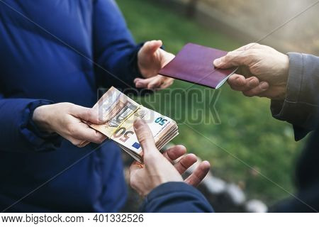 Identity And Travel Document Fraud - Person Buying Illegal Fake Passport