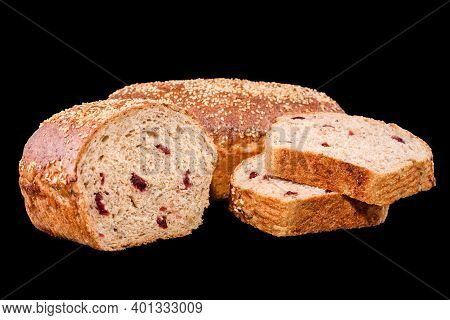 Freshly Baked Homemade Bread Isolated On Black. Cut In Half Rye Bread With Red Berries. Healthy Eati