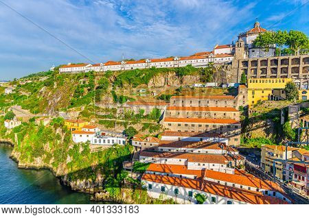 Monastery Of Serra Do Pilar With Catholic Church And Winery Buildings On Steep Slope Of Douro River