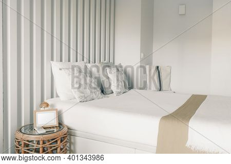 A Bright White Neatly Made Bed In A Bedroom Of A Residential Apartment Of A Hotel Room With Pillows