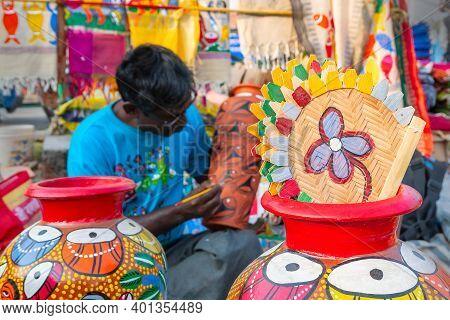 Kolkata, West Bengal, India - 31st December 2018 : Young Bengali Artist , Out Of Focus Man , Paintin