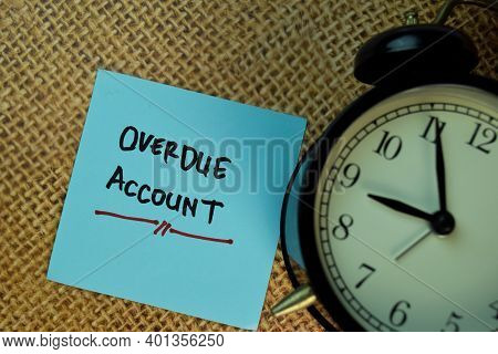 Overdue Account Write On Sticky Notes Isolated On Brown Burlap Laying On Table