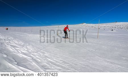 Sports Woman At Cross-country Skiing Or Langlauf Running In The Wintry Landscape.  15th Of March 202