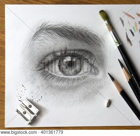 Realistic Drawing Of A Human Eye. Monochrome Hand Drawing. The Process Of Working On The Artist's De