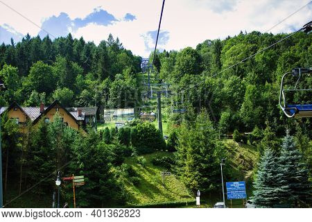 Bielsko Biala, South Poland - July 29, 2017: Chairlift Cable Open Car In The Beskid Polish Mountains