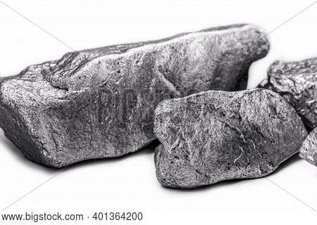 Raw Manganese. Manganese Stone Isolated On White Background. Mineral Extraction Of Heavy Metals.