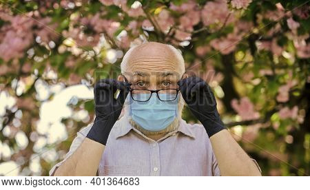Immune System Is Less Effective At Fighting Infections As We Get Older. Senior Man Wearing Face Mask