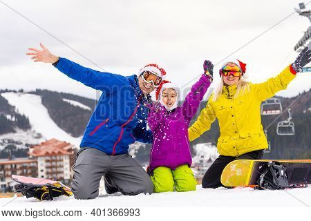 Winter Time And Skiing - Family With Ski And Snowboard On Ski Ha