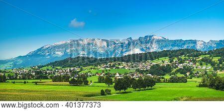 Liechtenstein Mountain Landscape With Beautiful Summer Green Grass Fields And Forest On Hills, Alpin