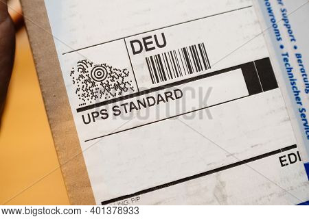 Paris, France - Dec 2020: Close-up Macro Shot Of Ups Standard Inscription On The Sticker Of A Delive