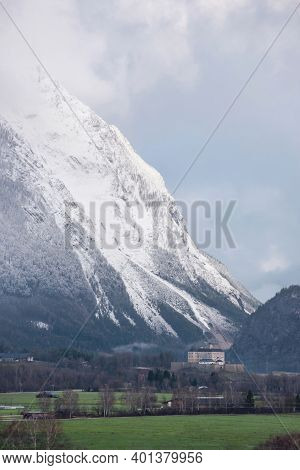 Winter Landscape With Snow Covered Grimming Mountain And Trautenfels Castle In The District Of Lieze