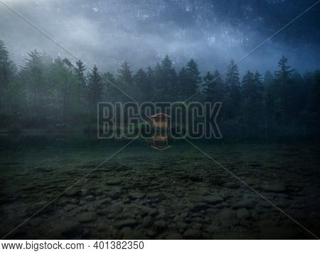 Low Clouds Fog Misty Mood Reflection Of Tree Forest Wood Cabin Boat House In Lake Bluntausee Golling