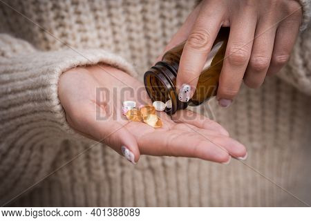 Close Up Of Woman Hands With Vitamins, Minerals And Supplements For Vegans From The Jar. B12, D3, K2