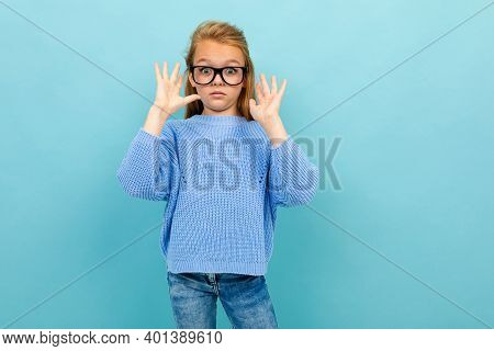 Attractive European Girl With Glasses On A Light Blue Wall With Copyspace With Copyspace.