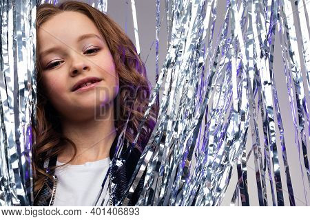 Attractive Teenager Girl On Birthday Against The Background Of Tinsel.