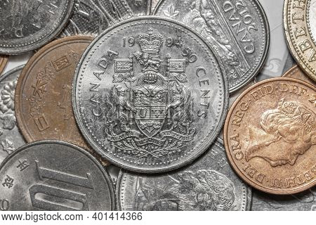 Detroit, MI- December 21, 2020 : Canadian 50 cents coin with other country coins.