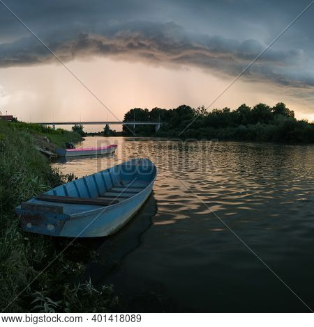 Storm Arcus Shaft And Cumulonimbus Cloud With Heavy Rain Or Summer Shower, Severe Weather And Sun Gl