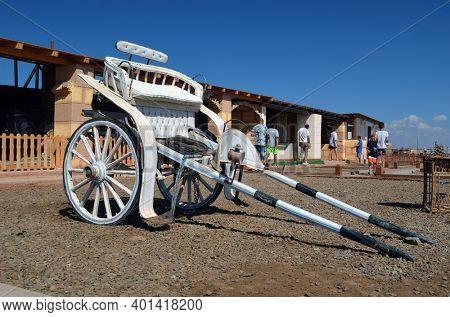 Old horse cart. Decoration on tourist stope location in desert near bedouin village near Sharm El Sheikh. November 8, 2020. Sharm El Sheikh, Egypt
