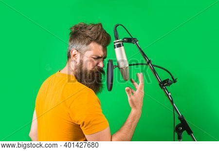 Studio Records. Bearded Man Sing In Microphone. Karaoke. Man Singing With Studio Microphone. Singing