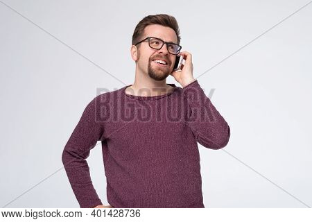 Happy Smiling Young Man Talking On Mobile Isolated On White Background