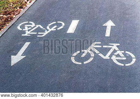 Bike Lane With Road Symbols Painting On Asphalt. Bicycle Sign On Street Surface. Bicycle Lane For Bi