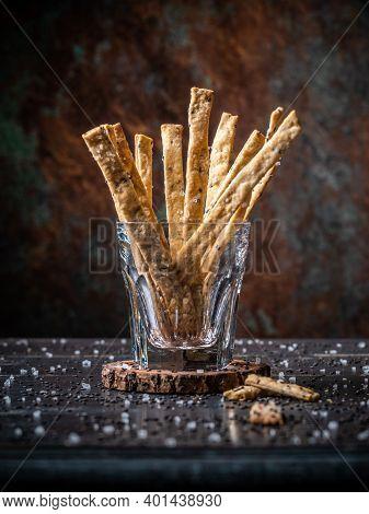 Black Sesame Rye Sourdough Crackers Served In A Glass