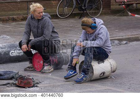 Kampen, The Netherlands Dec 31 2016 Boy And Girl Shooting Carbide