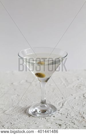 Margarita Cocktail In The Bar. Martini Glass Of Cocktail With Olives On White Background. Glasses Fo