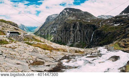 Trollstigen, Andalsnes, Norway. Bus Goes On Road Near Stigfossen Waterfall. Famous Mountain Road Tro