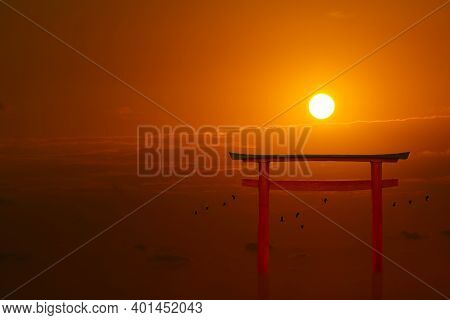 Torii Sunset Orange Red Cloud On Sky And Birds Flying On Sea