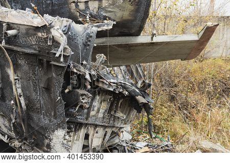 Plane Wreckage, Parts Of The Fuselage And Tail Of The Burned And Broken Aircraft At The Dump Of Non-