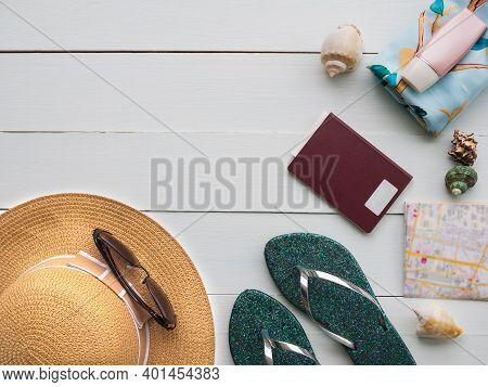Accessories Sea Travel Concept. Hat, Glasses, Sunscreen, Passport, Flipflop On Wood Background For S