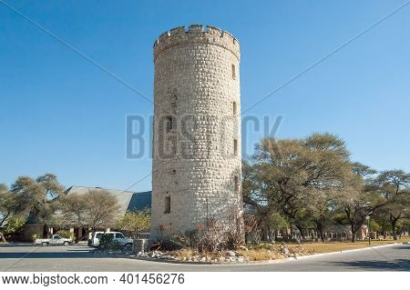 Etosha National Park, Namibia - June 16, 2012: Lookout Tower And Offices At Okaukeujo Rest Camp. Veh