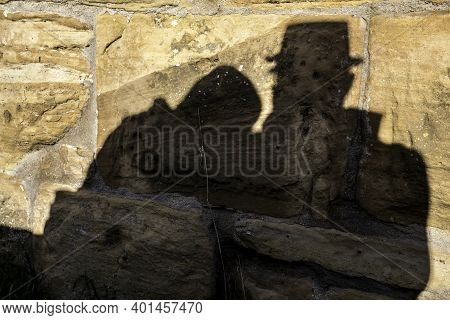 Shadows Of A Pair Of Lovers On The Big Rocks Of A Medieval Castle