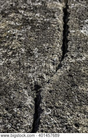 Deep Crack In The Big Rock Of The Wall Of A Castle