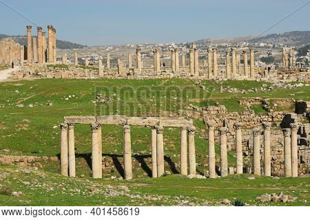 Jerash - February 15, 2020. The Greco-roman City Of Gerasa And The Modern Jerash In The Background I
