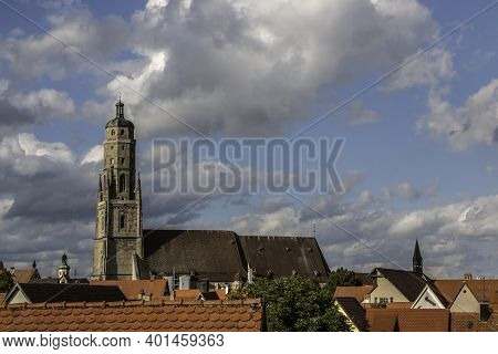 Old Church With High Church Tower And Cloudy Blue Sky