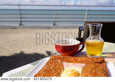 Kerisac Bowl Of Cider With A Breton Crepe Complete On The Terrace Facing The Sea
