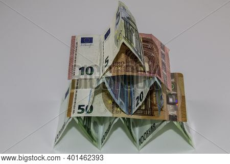 A Tiny Building Made Of Different Euro Banknotes