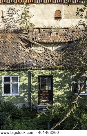 Broken Roof Of An Old House Near The City Wall