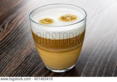 Transparent Glass With Latte-macchiato On Dark Wooden Table