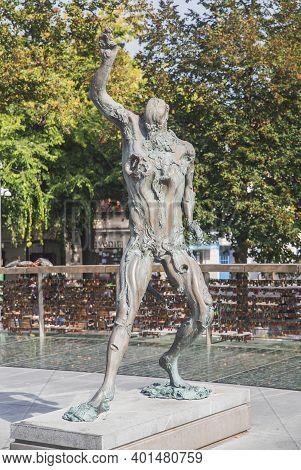 Ljubljana, Slovenia, October 2020: Statue Of Prometheus On Butcher Bridge In Ljubljana