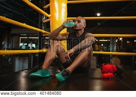 Full Length Shot Of A Young Athletic African Male Boxer Drinking Water After Training, Copy Space. M
