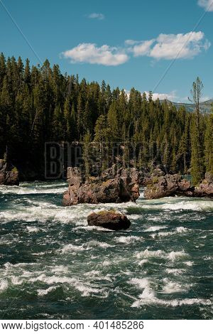 Island In The Yellowstone River With Rapids Surrounding It