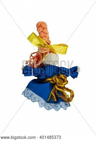 A Doll In A Blue Dress With A Yellow Belt. Traditional Russian Doll Made Of Fabric. Home Crafts.
