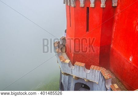 Sintra, Portugal, June 14, 2017: Red Defense Wall And Tower With Merlons Of Pena Palace With Green F