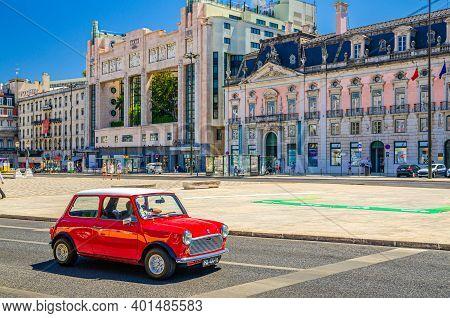 Lisbon, Portugal, June 15, 2017: Red Color Retro Vintage Car Riding In Restauradores Square Praca Wi