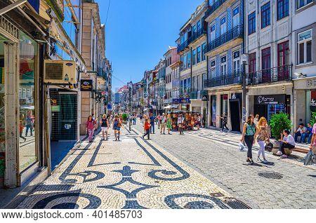 Porto, Portugal, June 23, 2017: People Tourists Walking Down Rua De Santa Catarina Cobblestone Pedes