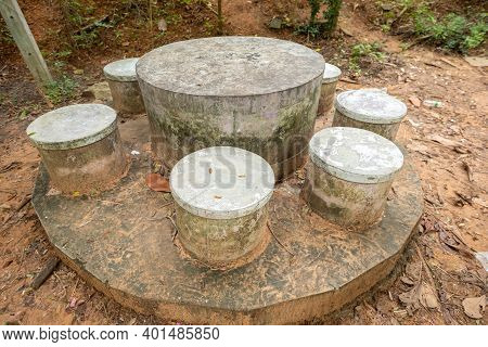 Cement Table And Chairs In A Shady Garden