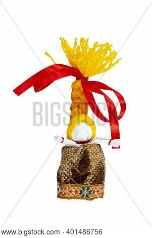A Doll With Yellow Hair And A Red Bow. Traditional Russian Doll Made Of Fabric. Home Crafts.